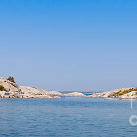 Les Palenik - Boat on a blue lake