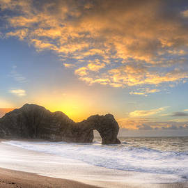 Matthew Gibson - Vibrant sunrise over ocean with rock stack in foreground