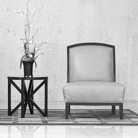 Rudy Umans - A chair and a table with a plant
