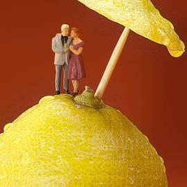 Paul Ge - A couple in lemon rain little people on food