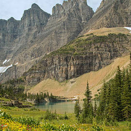 Natural Focal Point Photography - A Lake Near Iceberg Lake Along the Trail