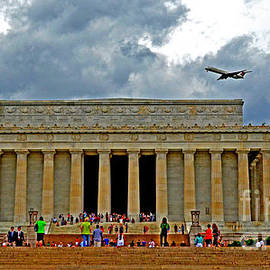 Jim Fitzpatrick - A Plane Flys Over the Lincoln Memorial on a Warm Rainy Day