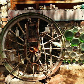 Jeff  Swan - A Wagon Wheel And Wall Of Bottles