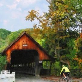 Susan Savad - Bicyclist at Middle Bridge Woodstock VT
