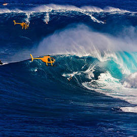 Nature  Photographer - Big surf at Jaws with helicopters capturing the day