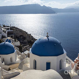IB Photo - Blue and white church in Oia village Santorini