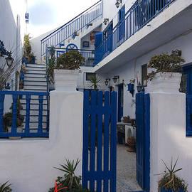 Colette V Hera  Guggenheim  - Blue White Santorini Hotel Greece
