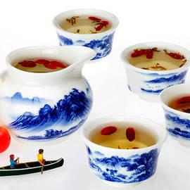 Paul Ge - Boating among china tea cups little people on food