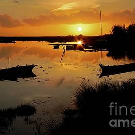 Angelo DeVal - Boats silhouettes at sunset