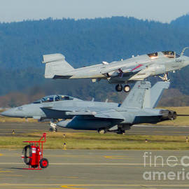 Joe Kunzler - Boeing EA-18G Growler Waiting for Homecoming Grumman EA-6B Prowler to Land