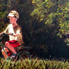 Uma Krishnamoorthy - Boy cycling