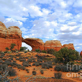 Catherine Sherman - Broken Arch in Arches National Park