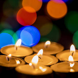 Vishwanath Bhat - Burning candles with colorful bokeh