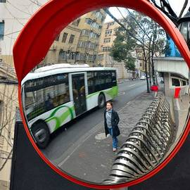 Imran Ahmed - Bus with woman in road safety mirror Shanghai China