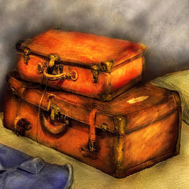 Mike Savad - Business Man - Packed Suitcases