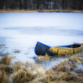 Alex Potemkin - Canoe at the frozen lake