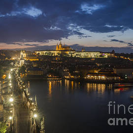 Bart De Rijk - Charles Bridge and Prague Castle after thunderstorm at night