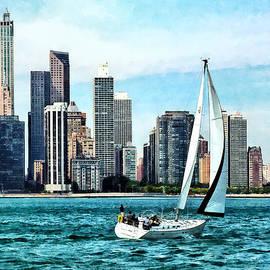 Susan Savad - Chicago IL - Sailboat Against Chicago Skyline