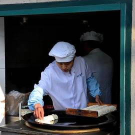 Imran Ahmed - Chinese chef cooks food on outdoor skillet Shanghai China