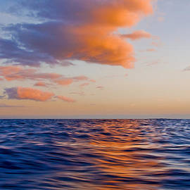 Nature  Photographer - Clouds at Sunset - Racing across the water at sunset