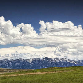 Randall Nyhof - Clouds over a Mountain Range in Montana