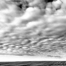 Jeff  Swan - Clouds Over A North Dakota Field