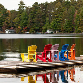 Les Palenik - Colorful chairs at the lake