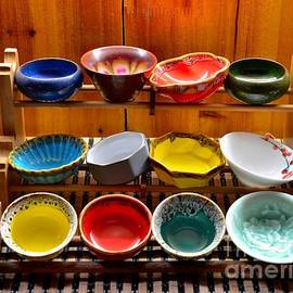 Imran Ahmed - Colorful glazed bowls displayed on wooden stand