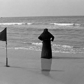 Kobi Amiel - Arab woman at the tel aviv beach/Black and Blue