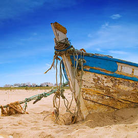 Amanda And Christopher Elwell - Dilapidated Boat at Ferragudo Beach Algarve Portugal