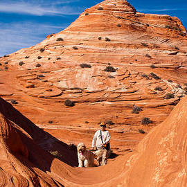 Robert Ford - Dog and Hiker Coyote Buttes Arizona and Utah