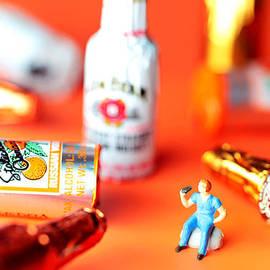 Paul Ge - Drinking among Liquor Filled Chocolate Bottles