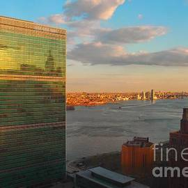 Miriam Danar - Famous Landmarks of New York - United Nations Building at Sunset with Chrysler Building Reflection