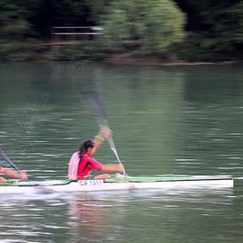 Imran Ahmed - Female canoe paddlers row in lake