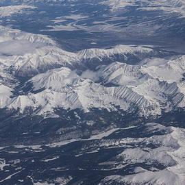 Georgia Mizuleva - Flying Over the Snow Covered Rocky Mountains