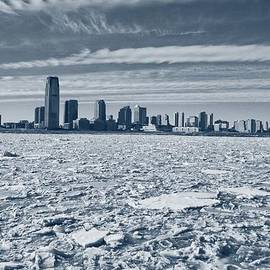 Nick Difi - Frozen Hudson River and a distant downtown Jersey City