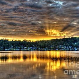 Geoff Childs - Golden Crepuscular sunrise water reflections.