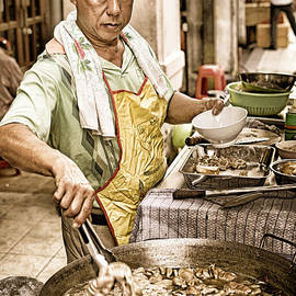 David Hill - Golden Glow - South East Asian Street Vendor Cooking Food at his Stall