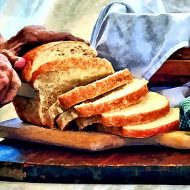 Susan Savad - Grandma Slicing Bread