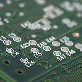 Matthias Hauser - Green printed circuit board closeup