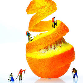 Paul Ge - Hikers climbing orange mountain