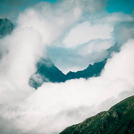 Raimond Klavins - Himalyas range in clouds at Tibet