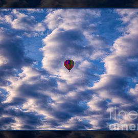 Omaste Witkowski - Hot Air Balloon in a Cloudy Sky Abstract Photograph