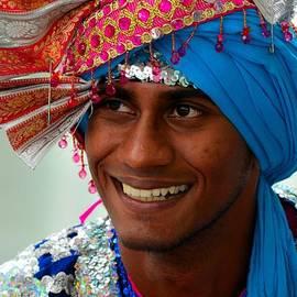 Imran Ahmed - Indian man smiles wearing colorful turban