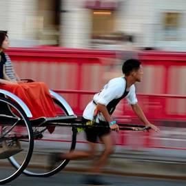 Imran Ahmed - Japanese tourists ride rickshaw in Tokyo Japan