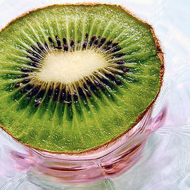 Louise Kumpf - Kiwi Fruit on a Pink and Blue Glass Plate