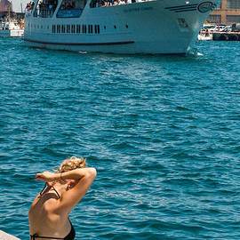 Robert Ford - Lady Catches some Sun along Toronto Harbor Waterfront Canada