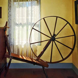 Susan Savad - Large Spinning Wheel Near Lace Curtain