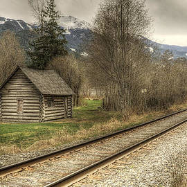Claudio Bacinello - Log Cabin and Railroad Tracks