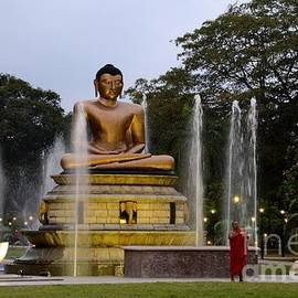 Imran Ahmed - Lotus Buddha statue with fountains in park with Buddhist monk Colombo Sri Lanka